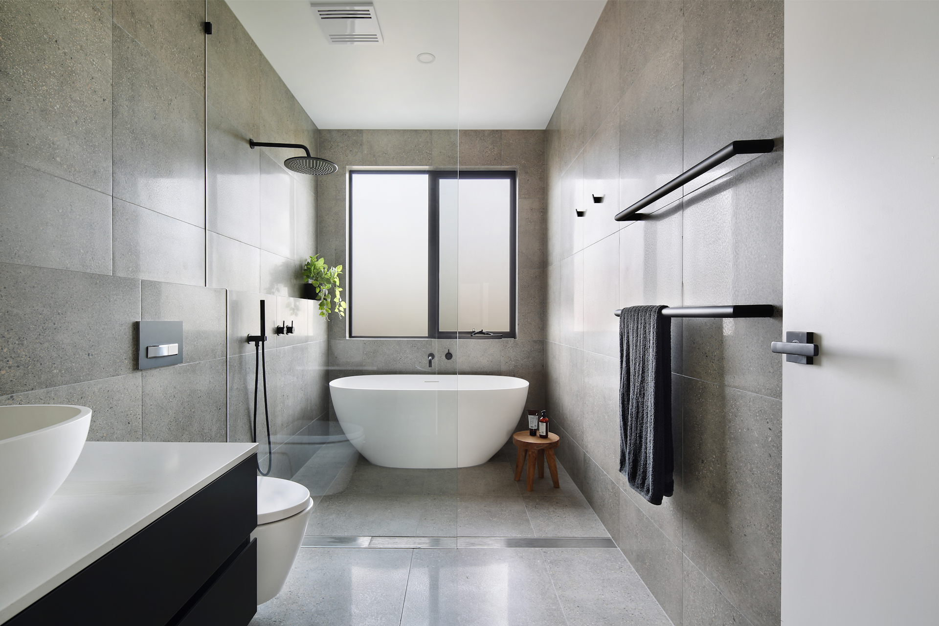 modern tiled bathroom with rainshower and boutique bathtub